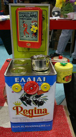 A toy kitchen stove made from reused tins and jar caps